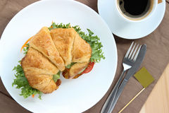Top view, closed up croissant bread sandwich with coffee. Royalty Free Stock Image