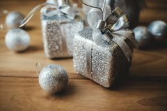 Top view closeup image of silver present boxes and Christmas decorations Stock Images