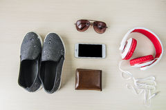 Top view of clothing and diverse personal accessory  on the wooden Royalty Free Stock Images