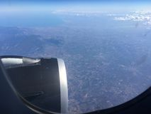 The top view of clouds and sky from an airplane window.  Royalty Free Stock Images