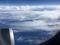 The top view of clouds and sky from an airplane window.  Royalty Free Stock Image
