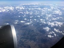 The top view of clouds and sky from an airplane window.  Royalty Free Stock Photo