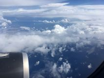 The top view of clouds and sky from an airplane window.  Stock Image