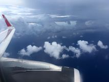 The top view of clouds and sky from an airplane window.  Royalty Free Stock Photos