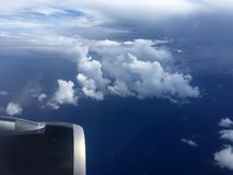 The top view of clouds and sky from an airplane window.  Royalty Free Stock Photography