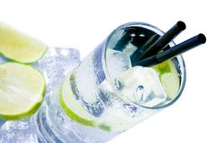 Top of view of cocktail glass with ice and lime slice Stock Image