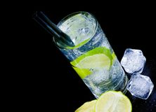 Top of view of cocktail with ice and lime slice with straw and space for text Stock Images