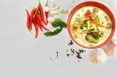 Top view of coconut milk soup with mushroom and meat surround by Royalty Free Stock Photography