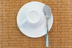 Top view of Coffe set with Thai style mat. Top view of Coffe set, an empty coffee cup with spoon and Thai style mat Stock Image
