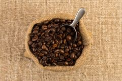 Top view of coffee bag on brown jute background Stock Photos