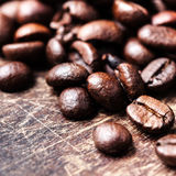 Top view of coffee beans on dark vintage background Royalty Free Stock Photography