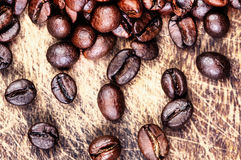 Top view of coffee beans on dark vintage background Royalty Free Stock Images