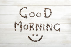 Top view of coffee beans making phrase Good morning with smile Royalty Free Stock Images