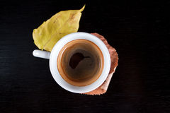 Top view of coffee cup with autumn leaves. Stock Image