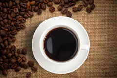 Top view coffee cup on burlap background royalty free stock photography