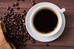 Top view /Coffee cup and coffee beans on table Royalty Free Stock Photo