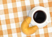 Top view coffee cup and croissant on tablecloth Royalty Free Stock Photo