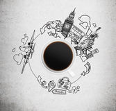 Top view of a coffee cup and drawn sketches of London and New York on the concrete background. Stock Photos