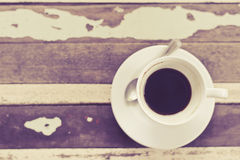 Top view of coffee cup on grunge wooden table in vintage style Royalty Free Stock Images
