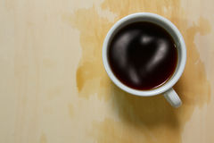 Top view of coffee cup and stains with heart topping Royalty Free Stock Photo
