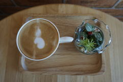 Top view from coffee cup and vase of flowers Royalty Free Stock Image