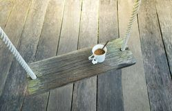Top view  coffee cup on wood swing Stock Photos
