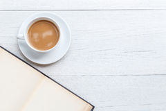Top view coffee and empty book on white wooden table Royalty Free Stock Images