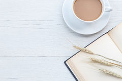 Top view coffee and empty book on white wooden table Royalty Free Stock Photography