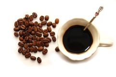 The top view coffee grains with coffee cup Royalty Free Stock Photos