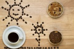 Top view coffee,muffins and figure sunny from Stock Image