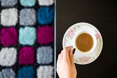 Top View Woman with Coffee Mug on Table. Top View Coffee Woman With Mug on a Table with a colorful carpet background Stock Images