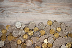 Top view coins on old wooden desk Royalty Free Stock Images