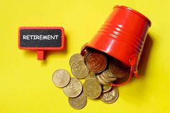 Top view of coins red pile and blackboard written with Retirement. Royalty Free Stock Images