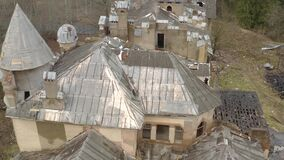 View on dilapidated roof of old building in forest