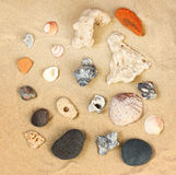 Top view of collection of beach stones rock and shells over sand Stock Photo