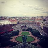 Top view from the colonnade of St. Isaac`s Cathedral on St. Isaac`s Square and the city. Saint-Petersburg, Russia. Square photo royalty free stock photo