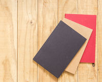Top view of color book on wooden table Stock Photography