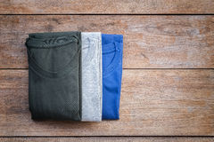 Top view of color T-Shirt on grey wood plank Stock Image