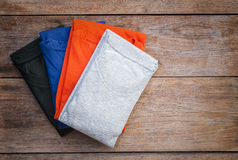 Top view of color T-Shirt on grey wood plank Royalty Free Stock Photography