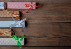 Top view of colored gift boxes on wooden background Royalty Free Stock Photo