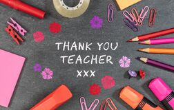 Thank you teacher text background with colorful school supplies.