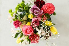 Top view of colorful bouquet of spring flowers - pink roses and royalty free stock photos