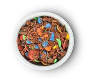 Top view of colorful chocolate buttons in bowl  on a white background royalty free stock images