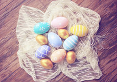 Top view of colorful easter eggs on cloth, retro filter effe Royalty Free Stock Photo