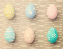 Top view of colorful easter eggs on cloth Stock Photos