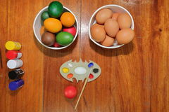 Top view of colorful Easter eggs with a paintbrush and palette Stock Images
