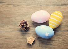 Top view of colorful easter eggs on wooden background Stock Images