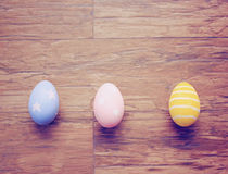 Top view of colorful easter eggs on wooden background Royalty Free Stock Photos