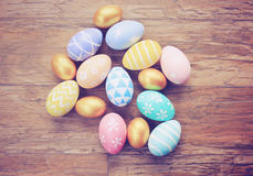 Top view of colorful easter eggs on wooden background Royalty Free Stock Images