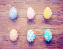 Top view of colorful easter eggs on wooden background Stock Photo
